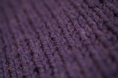 Texture of dark blue knitted woolen fabric. Closeup Royalty Free Stock Photos