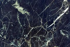 Texture of dark cracked marble, grunge background for design stock images