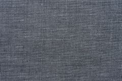 Texture of dark gray shirtless fabric without buttons close up shot royalty free stock photography