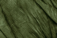 Texture of dark khaki crumpled fabric Royalty Free Stock Photography