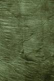 Texture of dark khaki crumpled fabric Stock Images