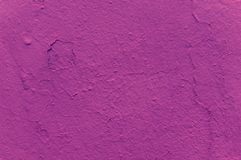 Texture of a dark pink shade on a concrete wall. Fashionable fuchsia color. Abstract background texture stock photos