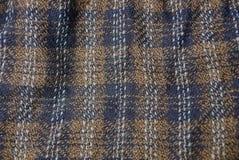 Texture de Brown d'un morceau d'habillement avec un modèle Images stock