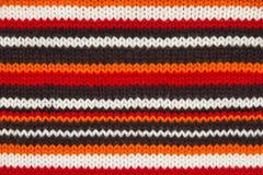 Texture de chandail de Knit. orange, noire et blanche Image stock