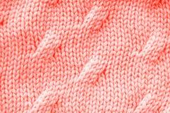 Texture de corail vivante de couleur Knitted photographie stock libre de droits