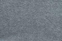 Texture de couleur tricotée laineuse de gris de tissu Images stock
