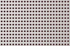 Texture de couper en plastique blanc de trou ou des trous de forage sur la toile, fond abstrait de modèle images libres de droits