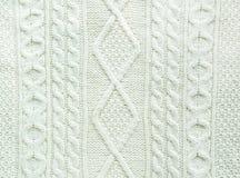 Texture de fait main tricoté Fin blanche de chandail de Noël  comme service de fond au papier peint Images stock