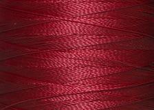 Texture de fil rouge dans la bobine Photographie stock