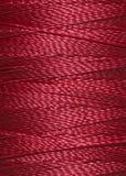 Texture de fil rouge foncé dans la bobine Image libre de droits