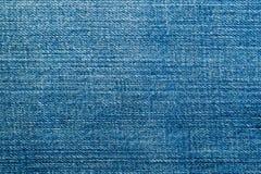 Texture de fin matérielle de denim bleu  images stock