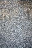 Texture de fond d'un mur gris de granit Fermez-vous luttent  Photo stock