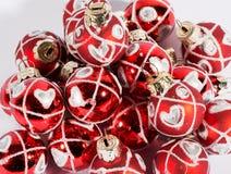 Texture de fond des babioles rouges de Noël Photographie stock libre de droits