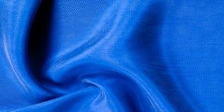 Texture de fond, modèle Profondément profondément tissu en soie de col bleu photographie stock libre de droits