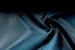 Texture de fond, modèle Tissu en soie iridescent de noir bleu Photo stock