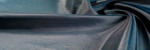 Texture de fond, modèle Tissu en soie iridescent de noir bleu Photographie stock