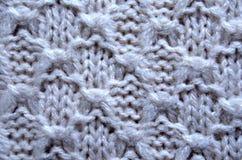 Texture de fond de modèle tricotée par beige abstrait peu commun Photos stock