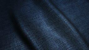 Texture de haute qualité bleu-foncé de jeans, vagues en mouvement Photos libres de droits