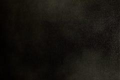 Texture de la poussière dans le vent au-dessus du fond noir Photo libre de droits