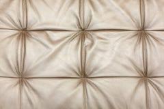 Texture de la tapisserie d'ameublement beige en cuir de sofa comme fond image libre de droits