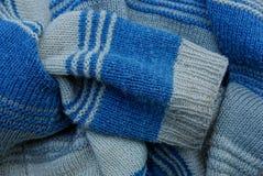 Texture de laine de gris bleu d'un chandail avec une douille Images libres de droits