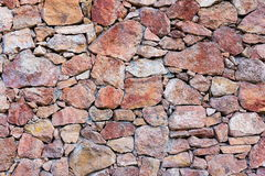 Texture de mur en pierre des pierres rouges Photos libres de droits