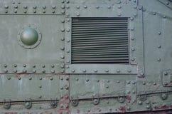 Texture de mur latéral de réservoir, faite de métal et renforcée avec une multitude de boulons et de rivets image libre de droits