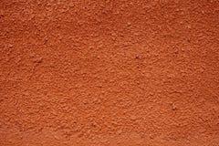Texture de mur plâtré rouge pour le fond photographie stock