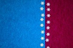 Texture de papier colorée avec des flocons de neige comme fond image libre de droits
