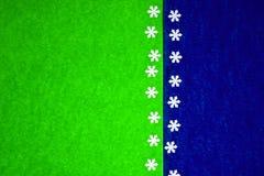 Texture de papier colorée avec des flocons de neige comme fond images libres de droits