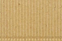 Texture de papier de goffer de carton ondulé, le vieil espace grunge vide vide texturisé serti par replis goffered réutilisé appr Photos libres de droits