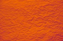 Texture de papier fortement fripée d'orange Photo stock