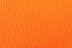 Texture de papier orange ondulé de couleur Photographie stock libre de droits