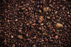 Texture de pierre de brun foncé, gravier Photographie stock libre de droits