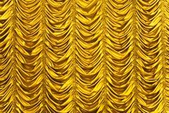 Texture de rideau en or Photo stock