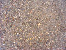 Texture de route goudronnée, texture de fond jaune de cailloux photo stock