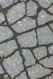 Texture de route de macadam avec des fissures - fond et texture abstraits Photo stock