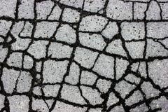 Texture de route de macadam avec des fissures - fond et texture abstraits Images libres de droits
