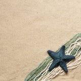 Texture de sable avec la décoration bleue Photo stock