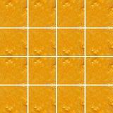 Texture de smoothie de mandarine à l'intérieur des formes carrées Photos libres de droits