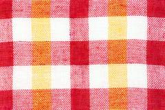 Texture de tissu avec un modèle à carreaux lumineux Noël Scrapbooking Serviette, tricotant, oeillets, Photographie stock