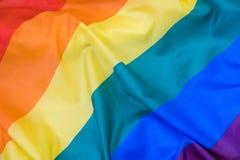Texture de tissu du fond gai de drapeau Drapeau de ondulation de LGBT Image stock
