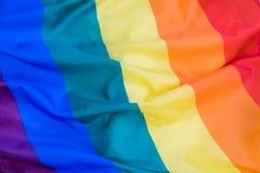 Texture de tissu du fond gai de drapeau Drapeau de ondulation de LGBT Images stock