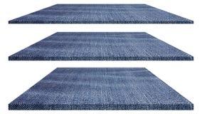 Texture de tissu de jeans de denim d'isolement sur le fond blanc pour la conception Photo stock