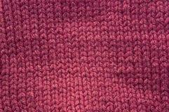 Texture de tissu tricoté par rose foncé Photos libres de droits