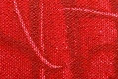 Texture de toile avec la peinture rouge Photos libres de droits