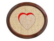 Texture de toile de toile de jute avec des coeurs dans le cadre en bois d'isolement sur le whi Photos stock