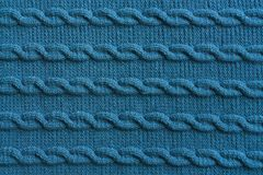 Texture de tricotage bleue faite main de tissu de laine Photo libre de droits