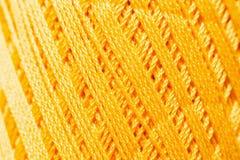 Texture de tricotage orange de fil, contexte d'ouvrage Photos libres de droits