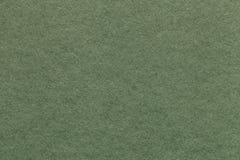 Texture de vieux fond de papier vert clair, plan rapproché Structure de carton olive dense Image libre de droits